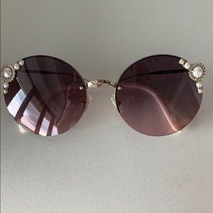 Miu Miu Manière Sunglasses.